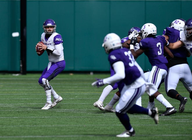 Abilene Christian quarterback Peyton Mansell looks for receiver against Stephen F. Austin on Oct. 24 at Globe Life Park in Arlington. Both teams join fellow former Southland Conference rivals Sam Houston State and Lamar in the Western Athletic Conference this season.
