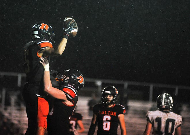 Dalton's Liam Riggenbach lifts Jaiden Malone in the air after he scored a touchdown for the Bulldogs.