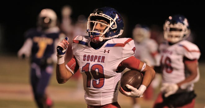 Cooper's Jett Villarreal (19) returns an interception 95 yards for a touchdown last season against Granbury. It was the Cougars only interception last year. Villarreal has one in each of the Coogs' first two games this season.