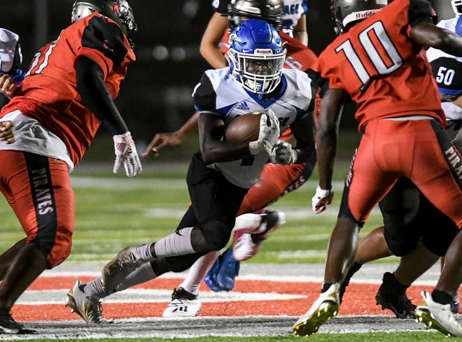 Jaquan Rock runs the ball for Heritage during the game against Palm Bay Friday, Oct. 23, 2020. Craig Bailey/FLORIDA TODAY via USA TODAY NETWORK