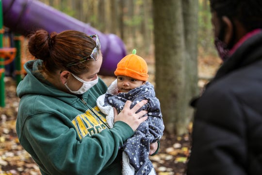 Melissa Maxwell, 35, of Detroit, introduces her daughter Zora Howard, 3 months old, to other mothers from Detroit Mama Hub during a meet-up at Bauervic Woods Park in Southfield, Mich. on Oct. 24, 2020. Detroit Mama Hub's mission is to improve the well-being of mothers through accessible, high-quality lactation and postpartum support so that mothers and their families can thrive.