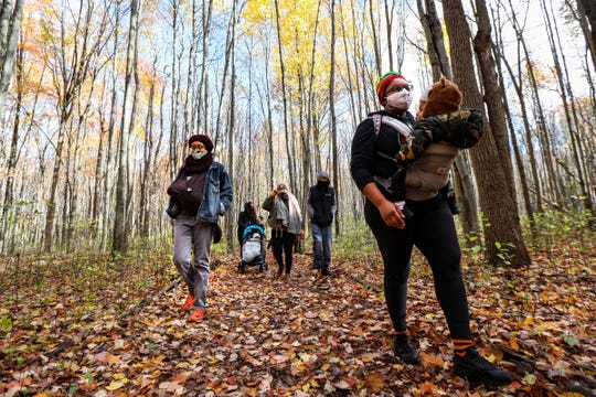 Members of Detroit Mama Hub, Myia Bennett, 27, of Redford Twp, left, Marya Ferguson, 28, of Detroit, right, and others walk on a nature trail at Bauervic Woods Park in Southfield, Mich. on Oct. 24, 2020. Detroit Mama Hub's mission is to improve the well-being of mothers through accessible, high-quality lactation and postpartum support so that mothers and their families can thrive.