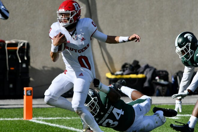 Rutgers quarterback Noah Vedral scores a touchdown against Michigan State on Saturday at Michigan Stadium.