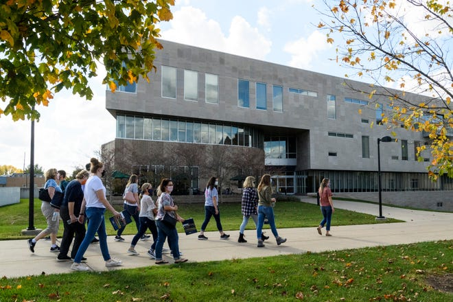 A tour group of prospective students walk towards the Business and Engineering Center on the University of Southern Indiana campus in Evansville, Ind., Thursday, Oct. 22, 2020.
