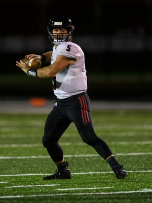 Southridge's Chase Taylor (5) looks to make a pass during the IHSAA Class 3A Sectional 32 matchup at Memorial Stadium in Mount Vernon, Ind., Friday, Oct. 23, 2020. The Raiders defeated the Wildcats 42-10 to advance to the sectional semifinals.