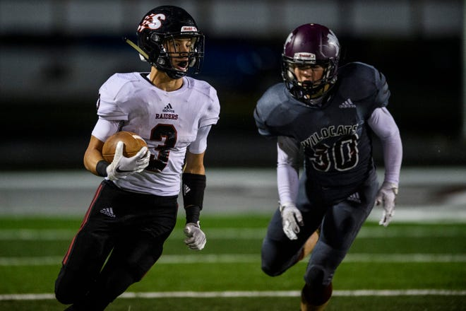 Southridge's Camden Gasser (3) drives the ball during the IHSAA Class 3A Sectional 32 matchup against the Mt. Vernon Wildcats at Memorial Stadium in Mount Vernon, Ind., Friday, Oct. 23, 2020.