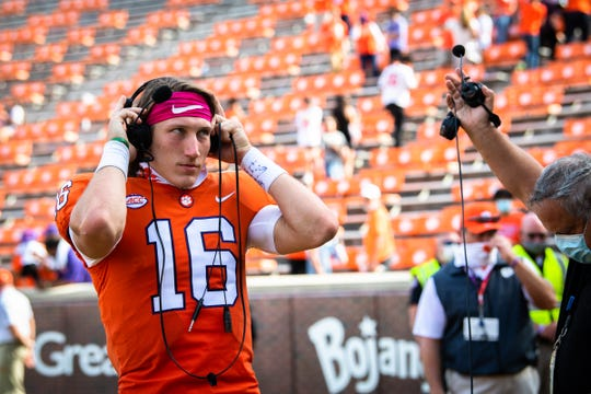 Sidelined because of a positive test for COVID-19, Clemson quarterback Trevor Lawrence (16) will serve as a student coach Saturday at Notre Dame, helping freshman D.J. Uiagalelei.