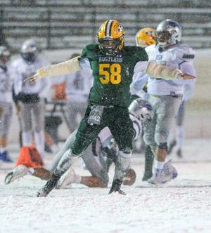 CMR's Bryce Hall celebrates making a stop during Friday's crosstown football game at Memorial Stadium.