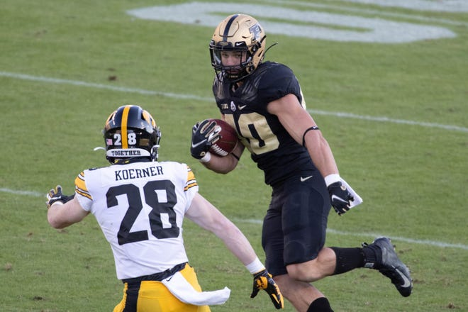 Oct 24, 2020; West Lafayette, Indiana, USA; Purdue Boilermakers running back Zander Horvath (40) runs the ball while Iowa Hawkeyes defensive back Jack Koerner (28) defends in the second quarter at Ross-Ade Stadium. Mandatory Credit: Trevor Ruszkowski-USA TODAY Sports