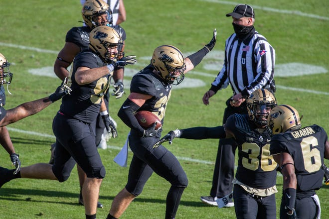 Oct 24, 2020; West Lafayette, Indiana, USA; Purdue Boilermakers safety Brennan Thieneman (38) celebrates recovering a fumble in the first quarter against the Iowa Hawkeyes at Ross-Ade Stadium.
