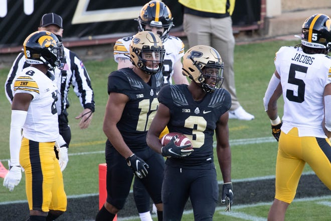 Oct 24, 2020; West Lafayette, Indiana, USA; Purdue Boilermakers wide receiver David Bell (3) celebrates his  touchdown in the second quarter against the Iowa Hawkeyes at Ross-Ade Stadium.