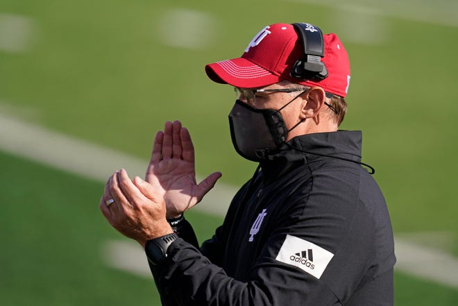 Indiana head coach Tom Allen encourages his team during the first half of an NCCAA college football game against Penn State, Saturday, Oct. 24, 2020, in Bloomington, Ind.