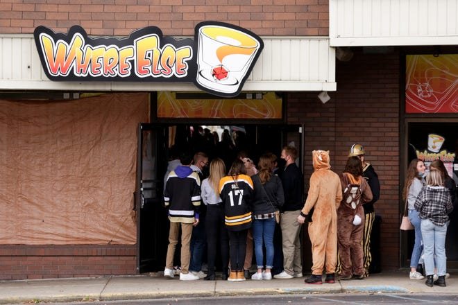 Bar-goers line up outside Where Else? before Purdue University's football game against Iowa, Saturday, Oct. 24, 2020 in West Lafayette.