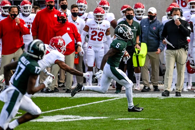 Michigan State's Jayden Reed runs for a touchdown after a catch against Rutgers during the first quarter on Saturday, Oct. 24, 2020, at Spartan Stadium in East Lansing.