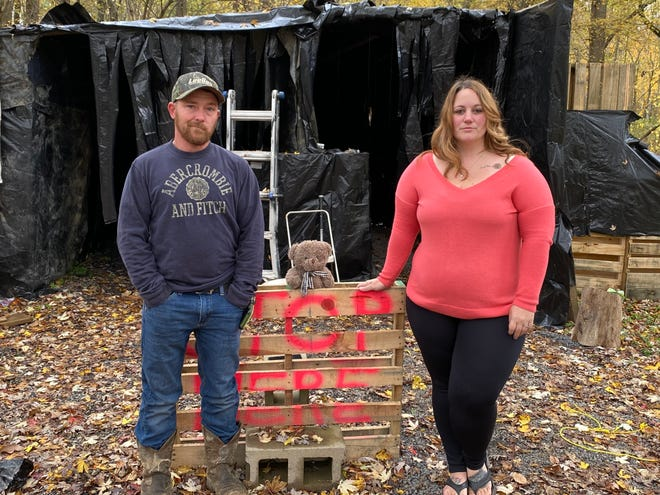 Bryan and Melinda McCartney stand outside the entrance to one of the mazes at The Dead Woods Saturday, Oct. 24, 2020. The McCartneys started the haunted attraction in 2017 after originally hosting it only for family and friends.