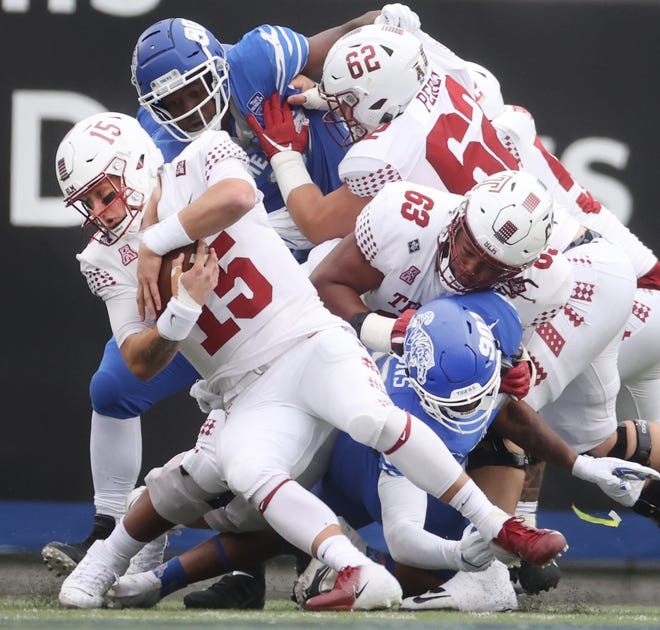 Memphis Tigers Jalil Clemons reaches through the pile to sack Temple Owls quarterback Anthony Russo at Liberty Bowl Memorial Stadium on Saturday, Oct. 24, 2020.