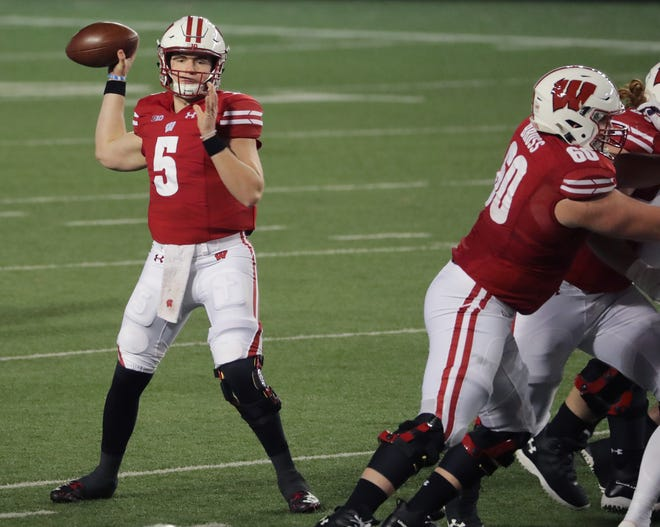 Wisconsin quarterback Graham Mertz looks and completes one of his 20 completed passes Friday night. Mertz only threw  one incompletion and threw four of his five touchdowns in the first half in Wisconsin's opening victory over Illinois,