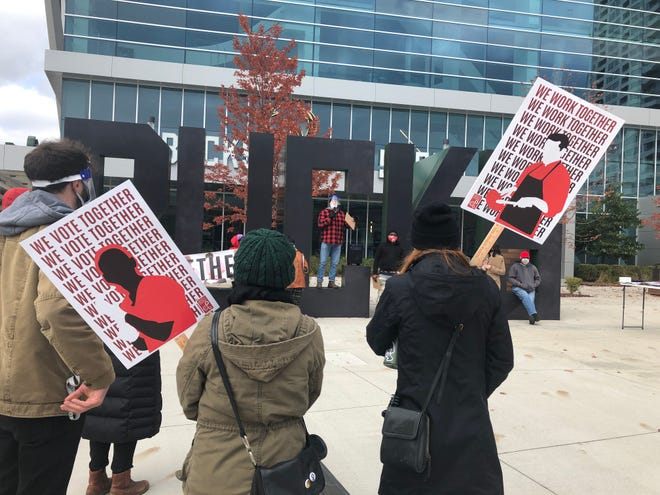 Workers gather outside Fiserv Forum to advocate for early voting on Saturday. Already 100,000 votes have been cast in the city of Milwaukee.