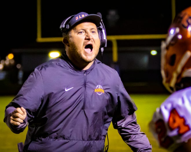 Blackman coach Kit Hartsfield shouts instruction to his team during Blackman's 30-7 win over Siegel Friday night.