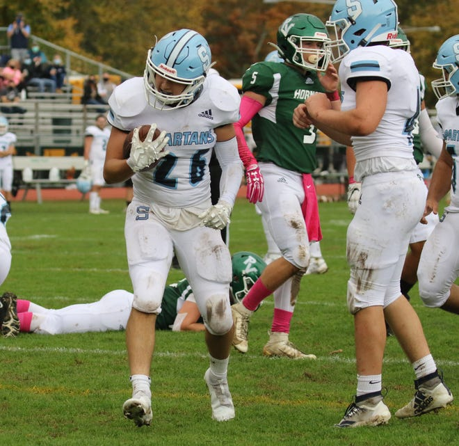 Sam Esposito of Sparta runs this play in for a TD as Sparta topped Passaic Valley 48-27