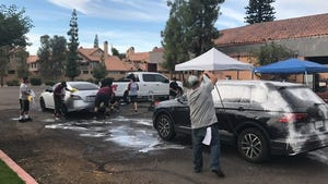 Volunteers wash cars, to benefit victims of the Oct. 16 Mesa shooting, near Mesa Drive and Brown Road on Saturday, Oct. 24, 2020.