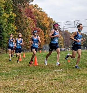The John Jay boys cross country team defeated rival Arlington in a dual meet on Oct. 24.