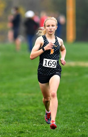 Northeastern's Margaret Carroll, seen here in a file photo, won the District 3 Class 3-A girls' individual cross country crown on Saturday.
