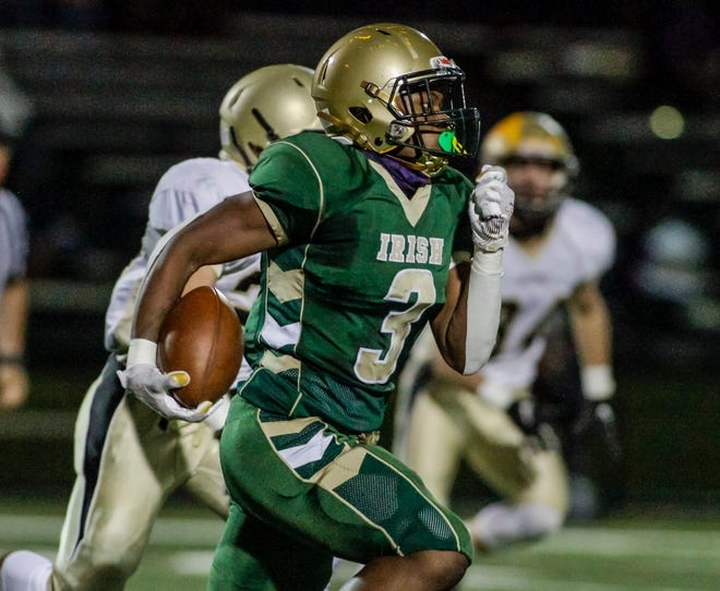 York Catholic's De'kzeon Wyche finds some running room against Delone Catholic last season. Wyche is one of a number of local athletes who endured a difficult recruiting season during the COVID-19 pandemic.