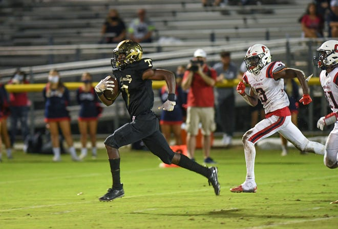 Treasure Coast High School's Jonius Watkins (from left) out sprints St. Lucie West Centennial defenders on a 65-yard run to score at the end of the 3rd quarter at the South County Stadium on Friday, Oct. 23, 2020, in Port St. Lucie. Treasure Coast won over Centennial, 28-20.