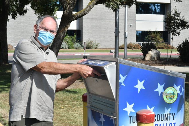 Doug Dethlefs drops his ballot off at a secure box in front of the Tulare County Elections Office on Oct. 24.