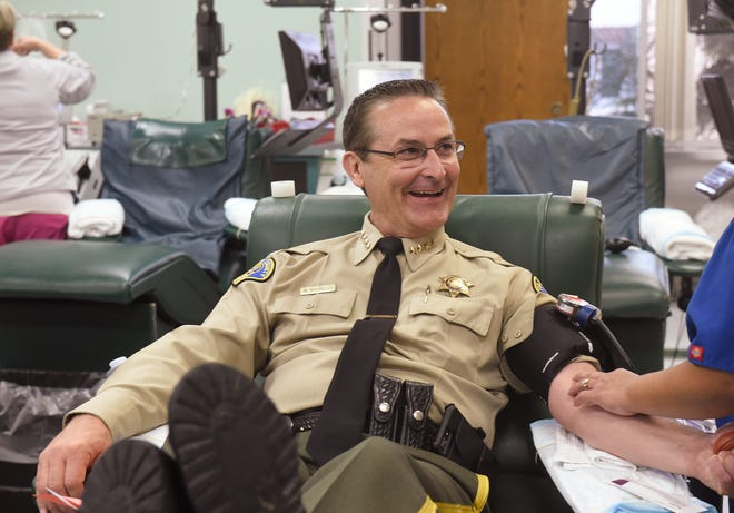 Sheriff Mike Boudreaux helped kick off the 16th annual Battle of the Badges Blood Drive Monday, Oct. 30, 2017, at the Central California Blood Center.