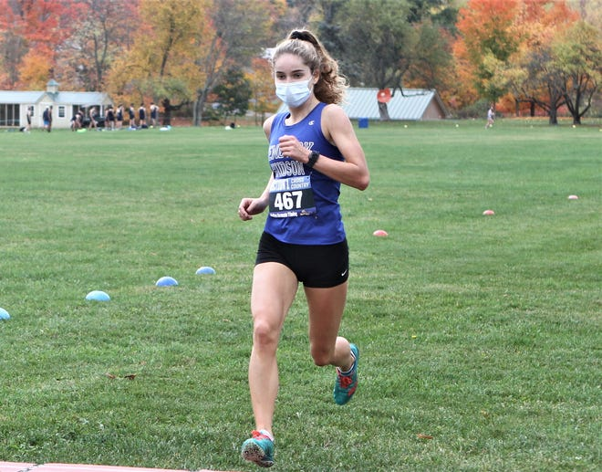 Hen Hud senior Isolde McManus hits the finish to win the girls first varsity race at the Section 1 Milton Invitational 2 cross-country meet Oct. 24, 2020. She ran 19:04.5.