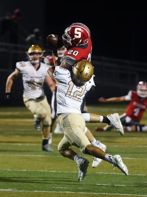 Landen Russell pulls down a fourth-down pass to keep a drive alive in Sheridan's 28-20 win against visiting Columbus Watterson in a Division III, Region 11 quarterfinal at Paul Culver Jr. Stadium.