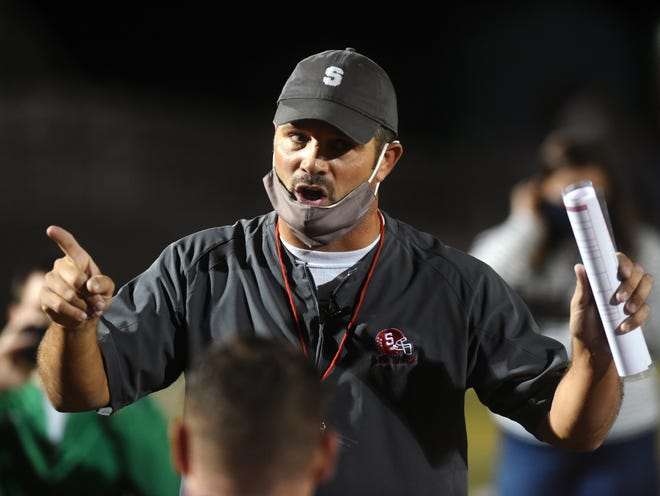 Sheridan coach Paul Culver III talks to the team after a 28-20 win against Columbus Watterson on Friday night during a Division III, Region 11 quarterfinal at Paul Culver Jr. Stadium.