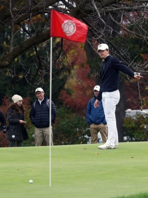 Drew Johnson, of Tri-Valley, gestures toward his ball on the 18th green on Saturday during the Division I state tournament at Ohio State's Scarlet Course. Johnson was named the Division I boys player of the year in the East District.
