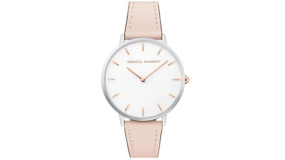This classic wrist watch is elevated with an always-on-trend blush hue.
