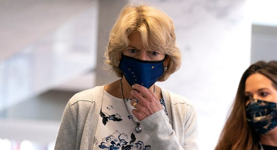 Sen. Lisa Murkowski, R-Alaska,  wears a protective mask at the weekly Senate Republican policy luncheon in the Hart Senate Office Building on Capitol Hill on Oct. 20, 2020 in Washington.