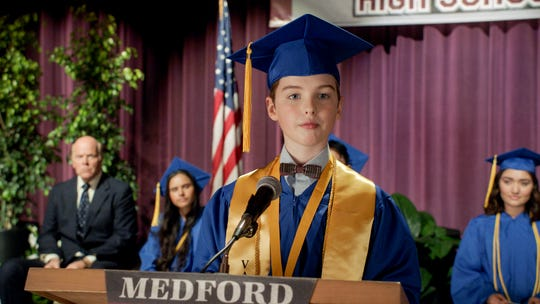 Eleven-year-old Sheldon Cooper (Iain Armitage) graduates from high school in the Season 8 premiere of CBS' 'Young Sheldon.' Sheldon was supposed to graduate as part of the Season 3 finale, but that was derailed after the COVID-19 pandemic shut down Hollywood production.