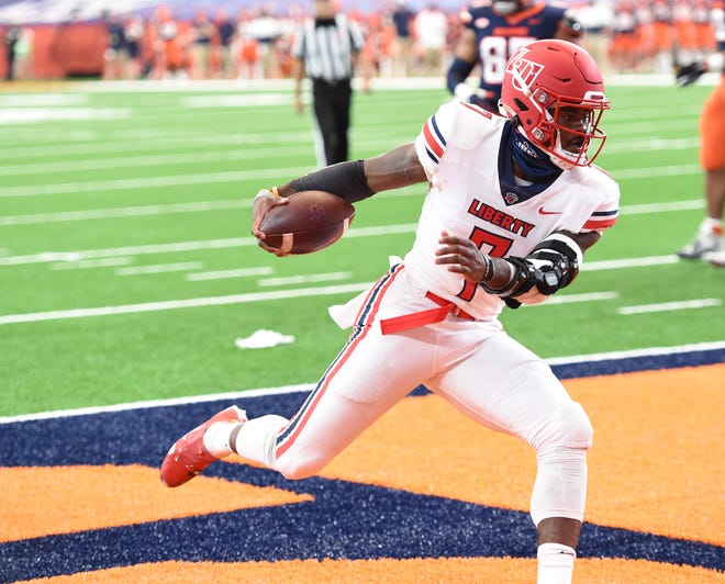 Liberty quarterback Malik Willis scores on a touchdown run in the first half during a game against Syracuse on Saturday, Oct. 17, 2020, at the Carrier Dome.