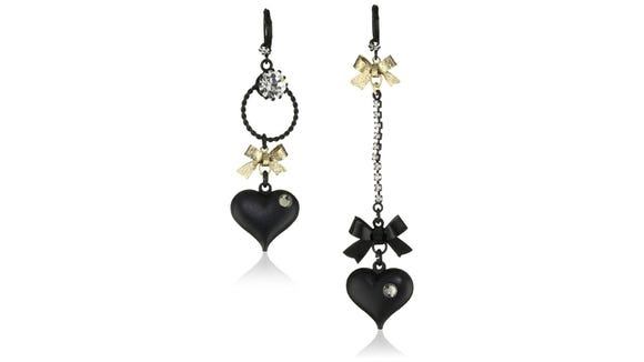 Mismatched earrings create an unexpected fashion twist.