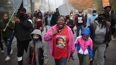 WAUKEGAN, ILLINOIS - OCTOBER 22: Demonstrators protest the October 20, police shooting that led to the death of 19-year-old Marcellis Stinnette and left his girlfriend, 20-year-old Tafara Williams, with serious injuries on October 22, 2020 in Waukegan, Illinois. About 100 protestors, including many family members of the shooting victims, marched from the shooting scene to City Hall, making stops at the police station and courthouse along the way. The demonstrators denounced violence but demanded accountability in statements along the way.