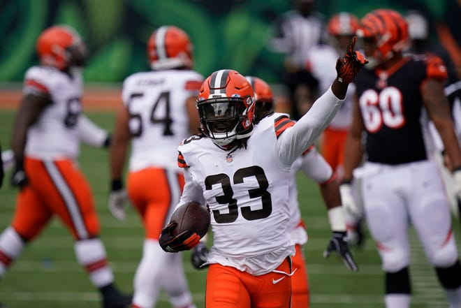 The Browns' Ronnie Harrison (33) celebrates a fumble recovery during the first half Oct. 25 against the Bengals in Cincinnati.