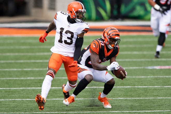Cincinnati Bengals cornerback Darius Phillips intercepts a pass intended for Browns wide receiver Odell Beckham Jr. during a game last  month.