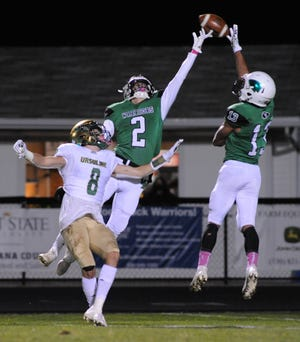 West Branch's Nicholas Wilson (2) and David McKeivier attempt to intercept a pass intended for Youngstown Ursuline's Matthew Reardon in an OHSAA Division IV playoff game at Clinton Heacock Stadium Saturday, October 24, 2020.
