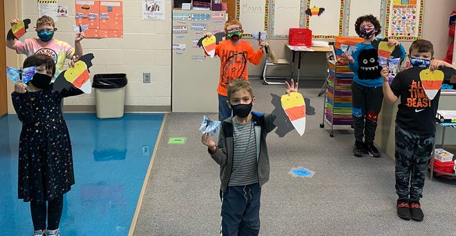 Alliance Elementary students made Halloween-themed bats out of coffee filters and bats whose bodies look like candy corn.