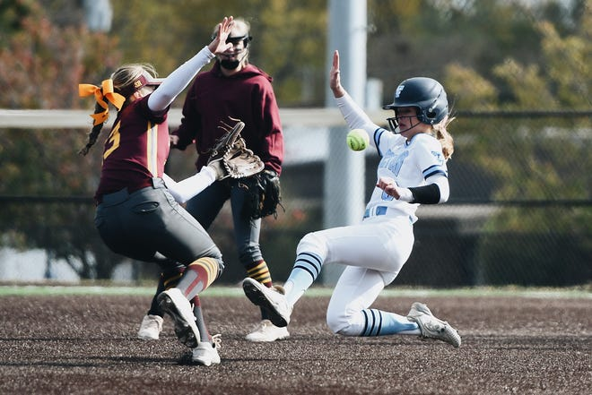 Tolton's Paige Bedsworth (6) slides as Kelly's Alaney Moore (13) moves to catch the ball during a Class 2 semifinal game Saturday at Hickman High School.