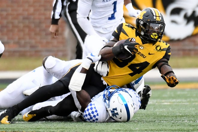 Missouri running back Larry Rountree (34) carries the ball during a game against Kentucky on Saturday at Faurot Field.