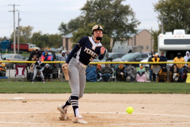 The index and middle fingers of her left (pitching) hand visibly swollen, Hamilton (Mo.): Penney HS softball Lady Hornets pitcher Julia Kanoy fires a low pitch to a Monroe City batter in the first inning of Saturday's (Oct. 24, 2020) Class 2 state tournament semifinal game at Hamilton. Her fingers having been pinched between the ball and bat when she fouled off a pitch in the top half of the inning, Kanoy had trouble gripping the ball and finding a release point that would get the ball close to home play on the first two Monroe City batters she faced, walking them on eight total pitches. However, she hung tough, figured out a grip that would let her get the ball over home plate, and came back to throw a scoreless first frame and eventually a complete-game win as Hamilton advanced to next Thursday's (Oct. 29) state-championship game at Springfield with a 10-3 triumph.