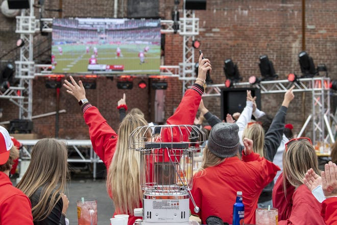 OSU students and fans cheer during kick off on OSU football opening day at Midway Bar on N. High Street in this Oct. 24, 2020, file photo.