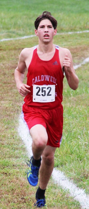 Caldwell's Andrew Sheanshang prepares to climb the last hill during Division III boys' district cross country on Saturday morning at Cambridge High School.